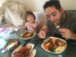 father and daughter in yorkshire eating sunday dinner